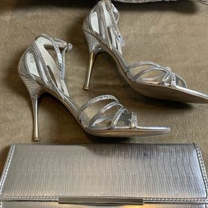 Pair of Silver Guess shoes and purse to match.